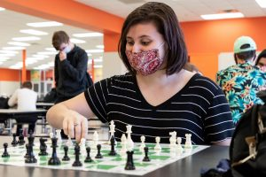 Senior Katarina Jordan places a round of chess during her enrichment. Jordan is the only girl competitor in class.