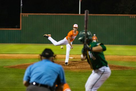 Pitcher Luke Smith launches a pitch during the home game against the Longview Lobos. The Tigers lost the game with a score of 4-2.