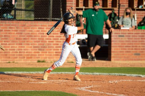 Junior Lauren Allred swings for a ball in the Lady Tigers home game against the Longview Lobos. The Tigers ended the game with a win of 9-3.