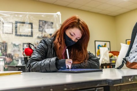 Amelia Stansbury works on one of her latest digital art pieces in class. After high school, Stansbury plans to teach art.