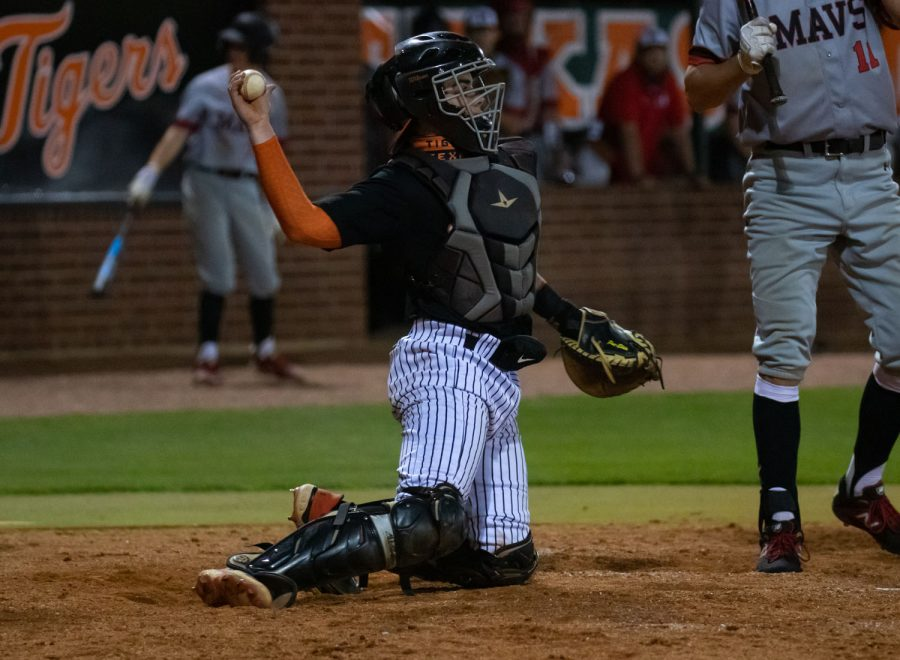 Catcher+Jackson+Halter+launches+a+ball+back+to+the+pitchers+mound+during+a+home+game+against+the+Marshall+Mavericks.+The+Tigers+lost+4-3.