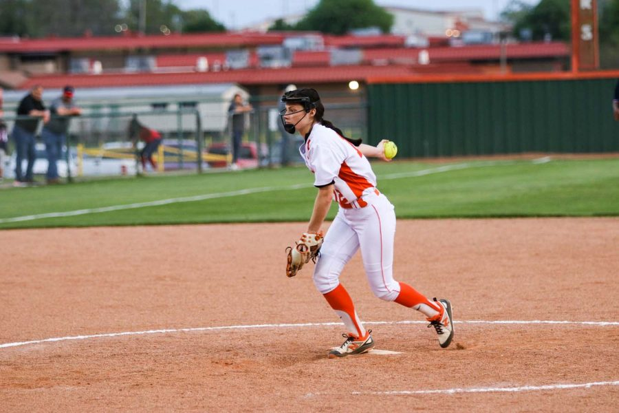 Pitcher Olivia Huckabee prepares to hurl a pitch in the Lady Tigers home game against the Marshall Mavericks. The Tigers won with a score of 6-4.