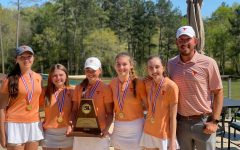 submitted photo. The Lady Tigers varsity golf team stands together after their tournament. The team advanced to Regionals on April 1.