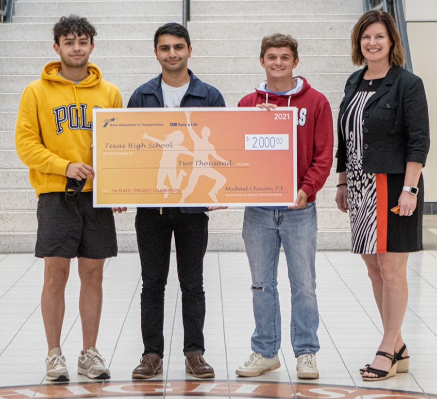 Seniors Logan Diggs, Assad Malik and Guy Johnson pose with principal Carla Dupree after winning the TxDOT Project Celebration Public Service Announcement video contest. Funds awarded to Texas High School from the contest help to fund the safe alternative after prom part Project Celebration.