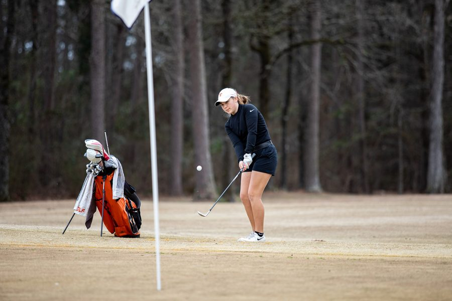 Senior Graci Henard takes a shot at Northridge Country Club. The team placed sixth at regionals on April 19-20.