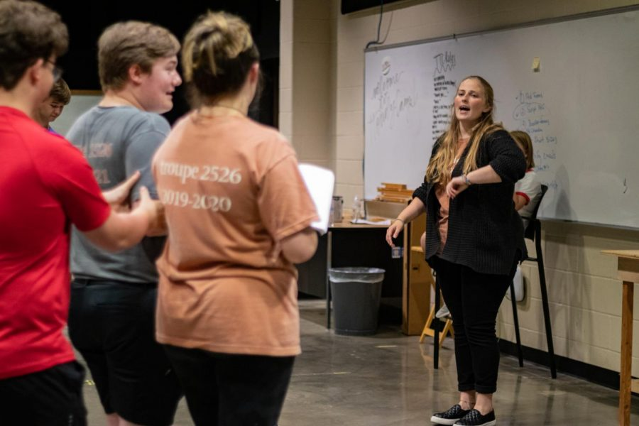 Theater director Bonnie Flieder guides sophomore Tyler Unger and senior Beth Dietze through their scenes during a rehearsal for