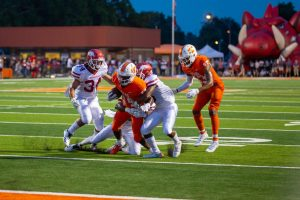 During the 2018 Texas v. Arkansas game Texas High Varsity football players attempt to break out of an opposing teammate's grasp to make it into the end zone. The Texas High Tigers played the Arkansas Razorbacks on September 8, 2018.
