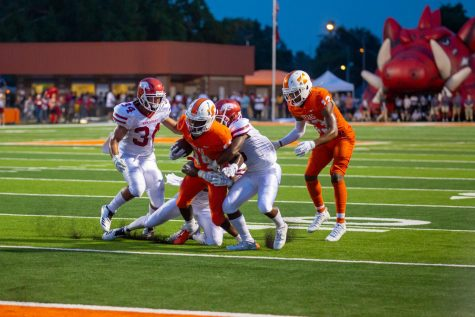 During the 2018 Texas v. Arkansas game Texas High Varsity football players attempt to break out of an opposing teammates grasp to make it into the end zone. The Texas High Tigers played the Arkansas Razorbacks on September 8, 2018.