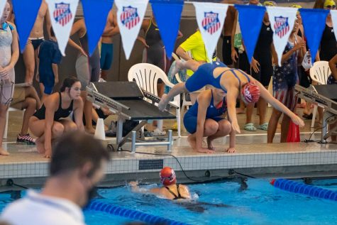 Senior Allyson Smith dives into the water during the 2021 Junior Olympics. Houston, Texas hosted the Junior Olympics July 28 through August 6.