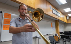 Band director Ryan Hadaway plays the trombone during a rehearsal. Hadaway moved here this school year from Arkansas High.