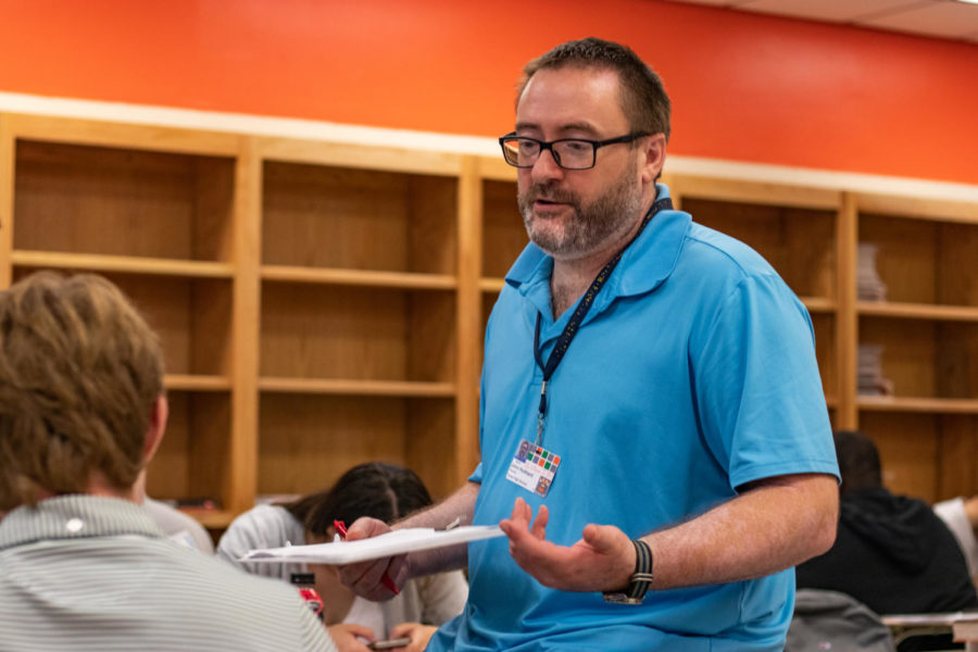 World history and geography teacher John Hubbard speaks to a student during class. Although he has previously worked in TISD, this is Hubbards first year teaching at Texas High.
