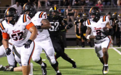 Senior Braylen Stewart rushes against Forney Jackrabbits on Thursday Sept. 9, 2021. The Tigers came back from a rough start to win with a final score of 34-13.