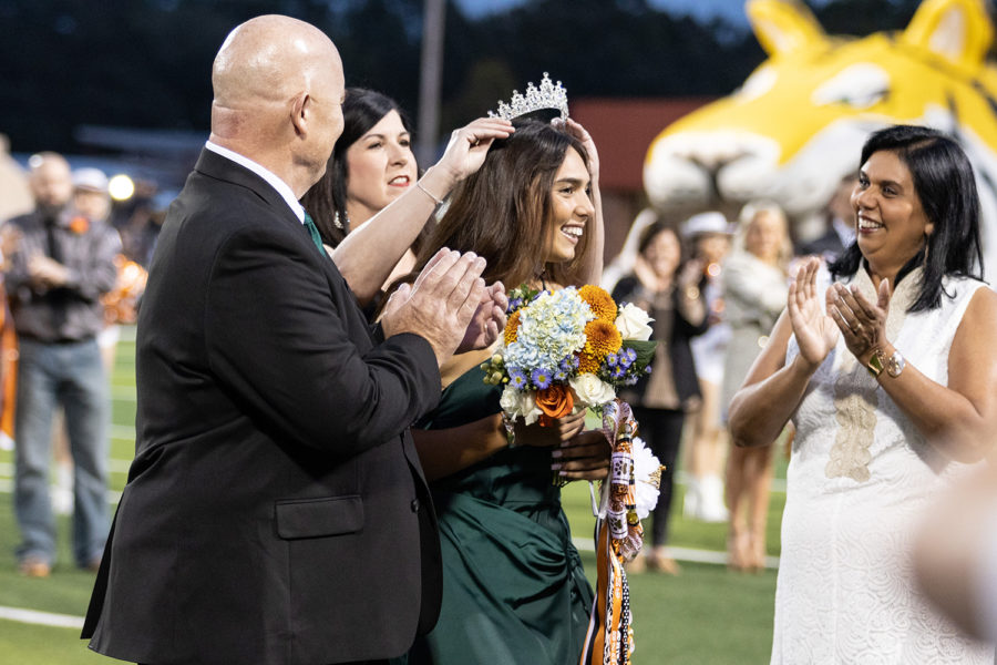 Principal Patti OBannon places the crown on senior Lauren Allreds head after being named homecoming queen Friday night at Tiger Stadium.