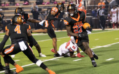 Texas Highs Javarous Tyson returns an intercepted lateral from the Marshall Mavericks quarterback in the Tigers 27-12 victory at Tiger Stadium on Oct. 9, 2021. The Tigers improved their season record to 4 - 0 overall and 1 - 0 in district play.