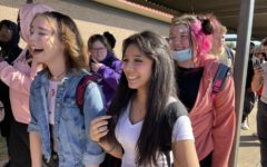 In line to enter the pep rally Oct. 22, juniors Emily Richey, Liv Balderas and Cindy Britton show their support for breast cancer awareness by wearing pink. Students wore different colors each day of the week in order to bring awareness to the many types of cancer.