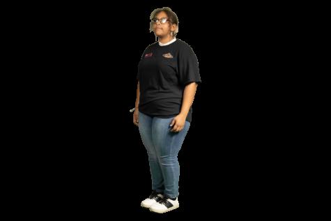 Junior Anastazia Gross stands in her work uniform.